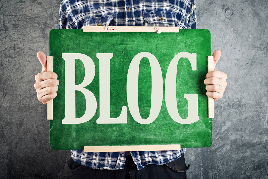 Teacher holding green chalkboard with title BLOG. Blogging concept.