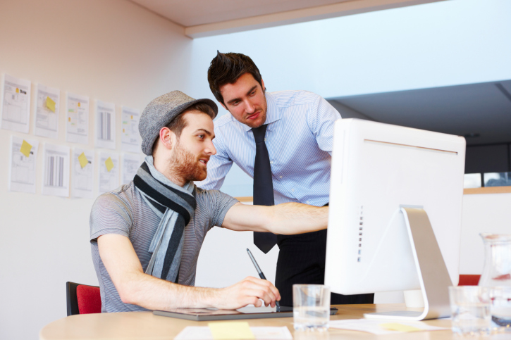 Office Worker Showing Design to a Colleague